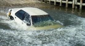 Vehicle submerging off boat ramp