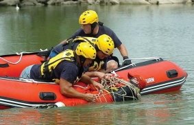 Rescue victim into inflatable boat