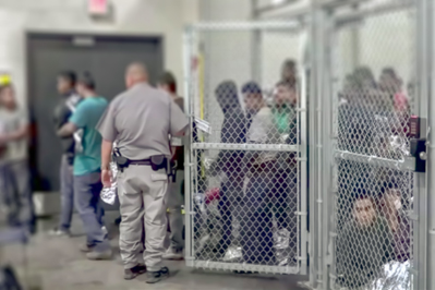 Migrants in a Detention Facility