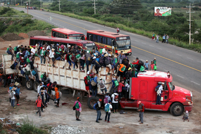 Migrants Getting onto a Truck Near the Border