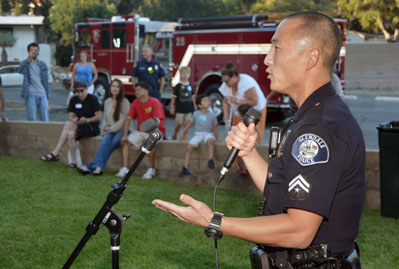 Police Officer Speaking at a Community Meeting