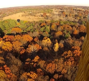 Michigan fall colors are spectacular flying OVER tree tops in a hot air balloon