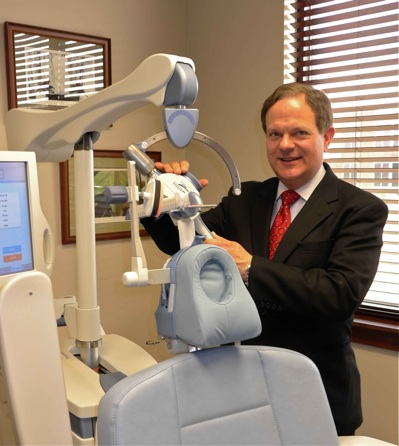 Louis Cady, MD with TMS machine