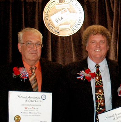 NALC Pres. William Young (r) presents Hero of the Year Award to letter carrier Wayne Viger 9/20 (photo by Mike Shea)