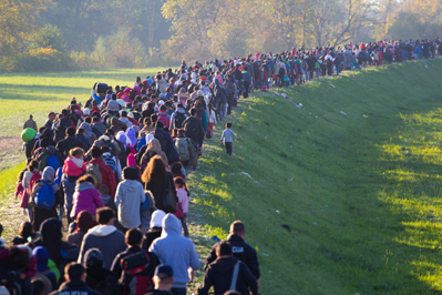 Refugees Streaming Towards Border